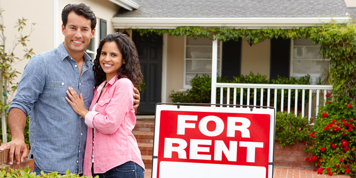 happy couple next to for rent sign - Rental Properties in Pittsburgh